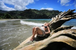 Katie, resting with no one else there but me and this petrified log in the ocean!