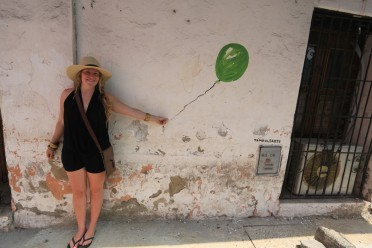 Katie holding up a wall in Cartagena