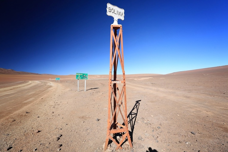 The border of Chile and Bolivia at the edge of the salar at around 13,000 feet above sea level.