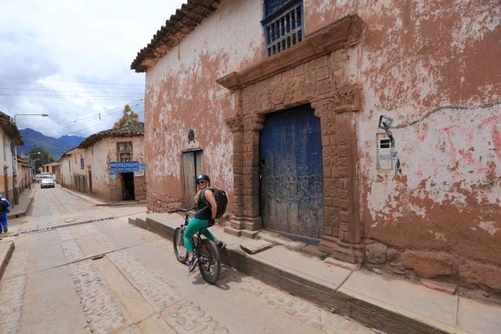 Katie biking through a colonial Peruvian town