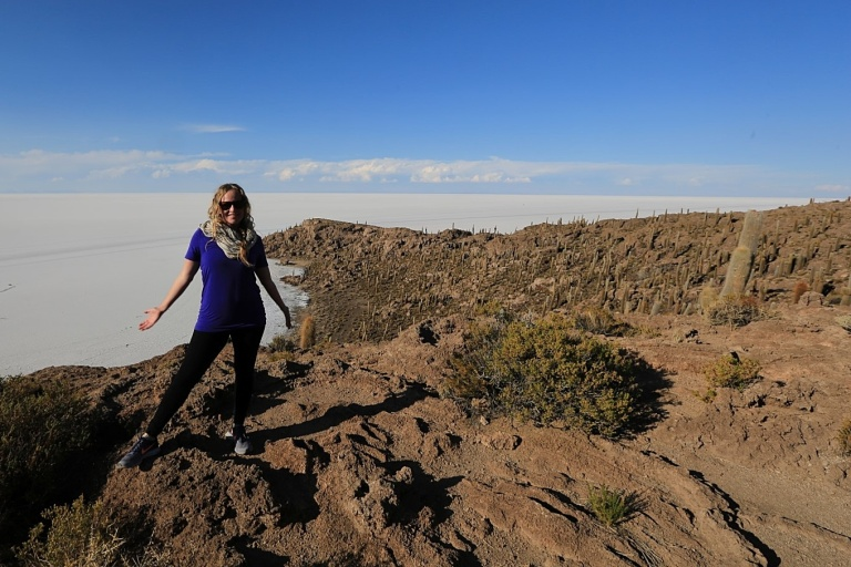 "Katie standing on the cactus island in the sea of salt (no water).  It's the only ""land"" for miles."