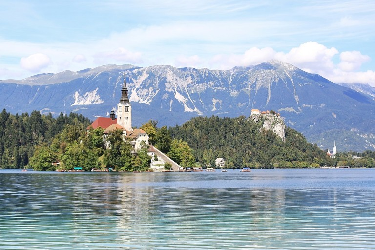 Oh, Look, a church on an island in a clear blue lake, with a castle and mountains.  Sure.  Right.