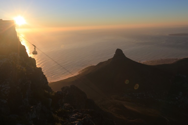 The sun setting against the cable car that goes to Table Mountain