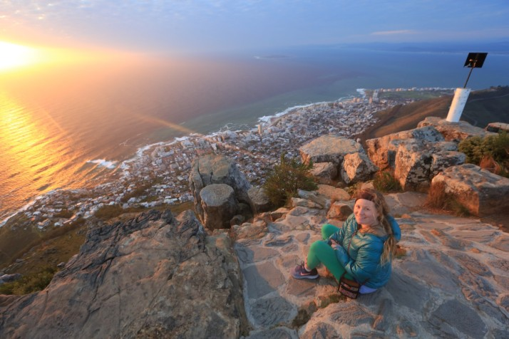 Katie sits on the Lion's Head mountain overlooking Cape Town