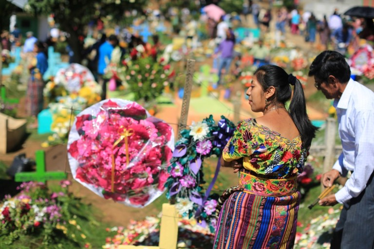 In addition the graves at the cemetery near by are decorated vibrantly.