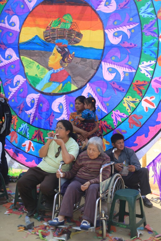 Families sit in front of the kites to display their pride